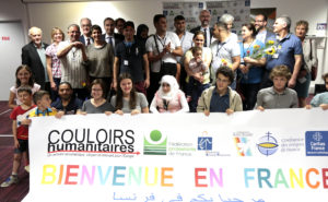 people holding a banner saying Bienvenue en France