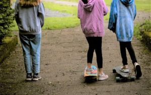 Three girls with skateboards