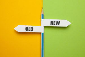 """a pencil with two flags. the first one says """"old"""", the second one """"new"""""""