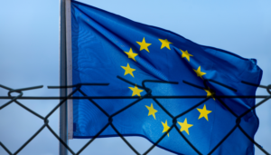 the EU flag behind a fence
